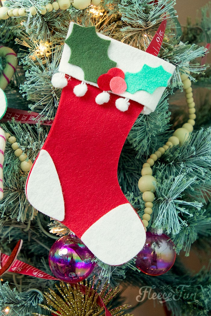 This Felt Stocking Ornament  DIY with FREE template can be sued so any ways! Hand it on the tree, string it from garland or use it to hold a gift card!  The best part about this Christmas tree ornament is that it is No Sew