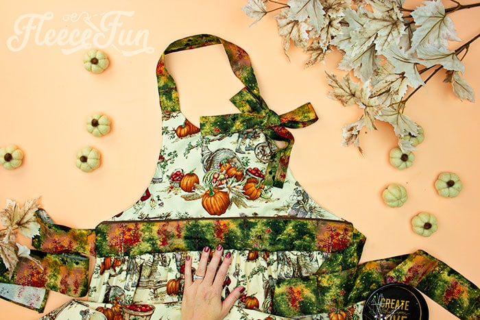 finished apron. This Free apron pattern and tutorial includes a pdf pattern and video! Make a vintage style apron that is chic.