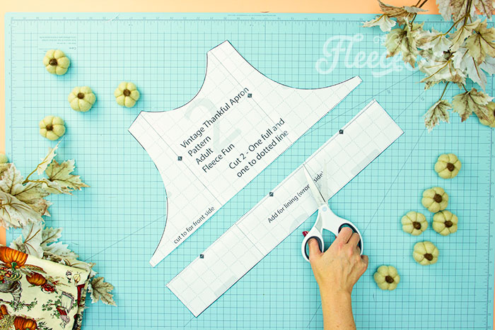 picture of how to cut the free apron pattern down to cut out front of bodice. This Free apron pattern and tutorial includes a pdf pattern and video! Make a vintage style apron that is chic.