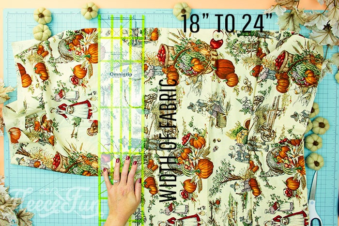 skirt being cut out from fabric for apron. This Free apron pattern and tutorial includes a pdf pattern and video! Make a vintage style apron that is chic.