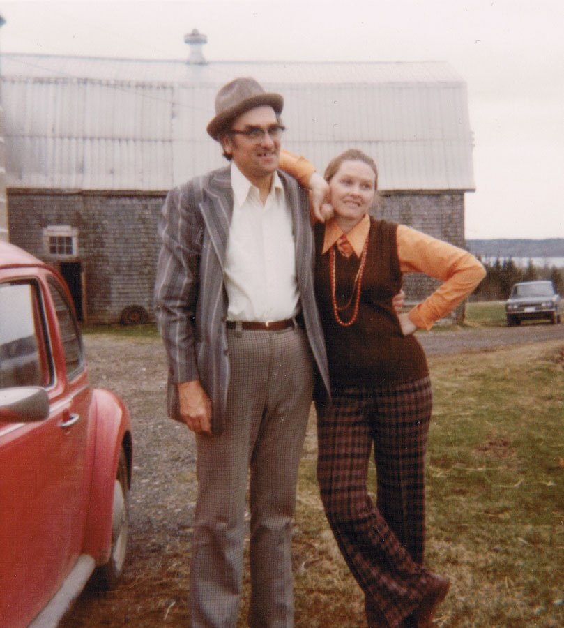 Around 1973, looking hip, with a red VW beetle