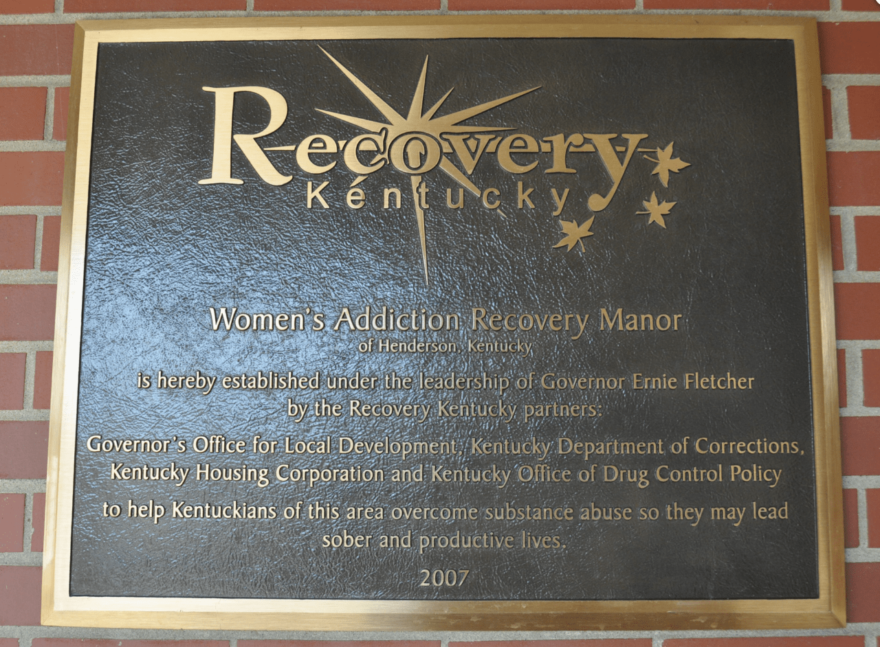 WARM RECOVERY PLAQUE ON ENTRANCE