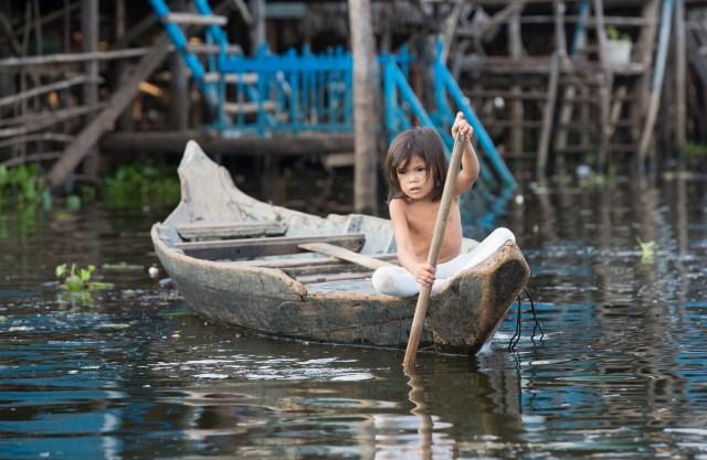 Girl in Boat, Floating Village, Cambodia