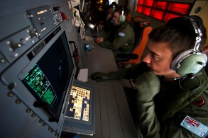 Royal Australian Air Force (RAAF) Airborne Electronics Analyst Sergeant Matthew Falanga studies a console on board an AP-3C Orion maritime patrol aircraft while searching for signs of Malaysia Airlines flight MH370 over the southern Indian Ocean. Image: © Commonwealth of Australia, Department of Defence