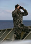 Able Seaman Maritime Logistics – Chef Bradley Fox keeps lookout on the forecastle of HMAS SUCCESS whilst the ship is deployed in search of the missing Malaysia Airlines Flight MH370. Image © Commonwealth of Australia, Department of Defence