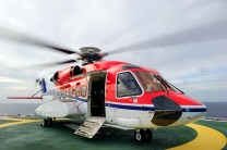 An offshore helicopter is waiting for passengers on the helideck