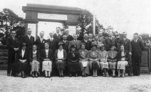 We're not sure what this occasion is or what group this is. We estimate it to be about 1947 and is possibly when the Second World War names were added. The clothes certainly suggest that period.