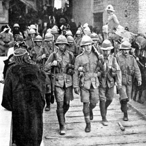 British troops march through the streets of Kut-el-Amara in Mesopotamia, after they recaptured the city on February 25, 1917.