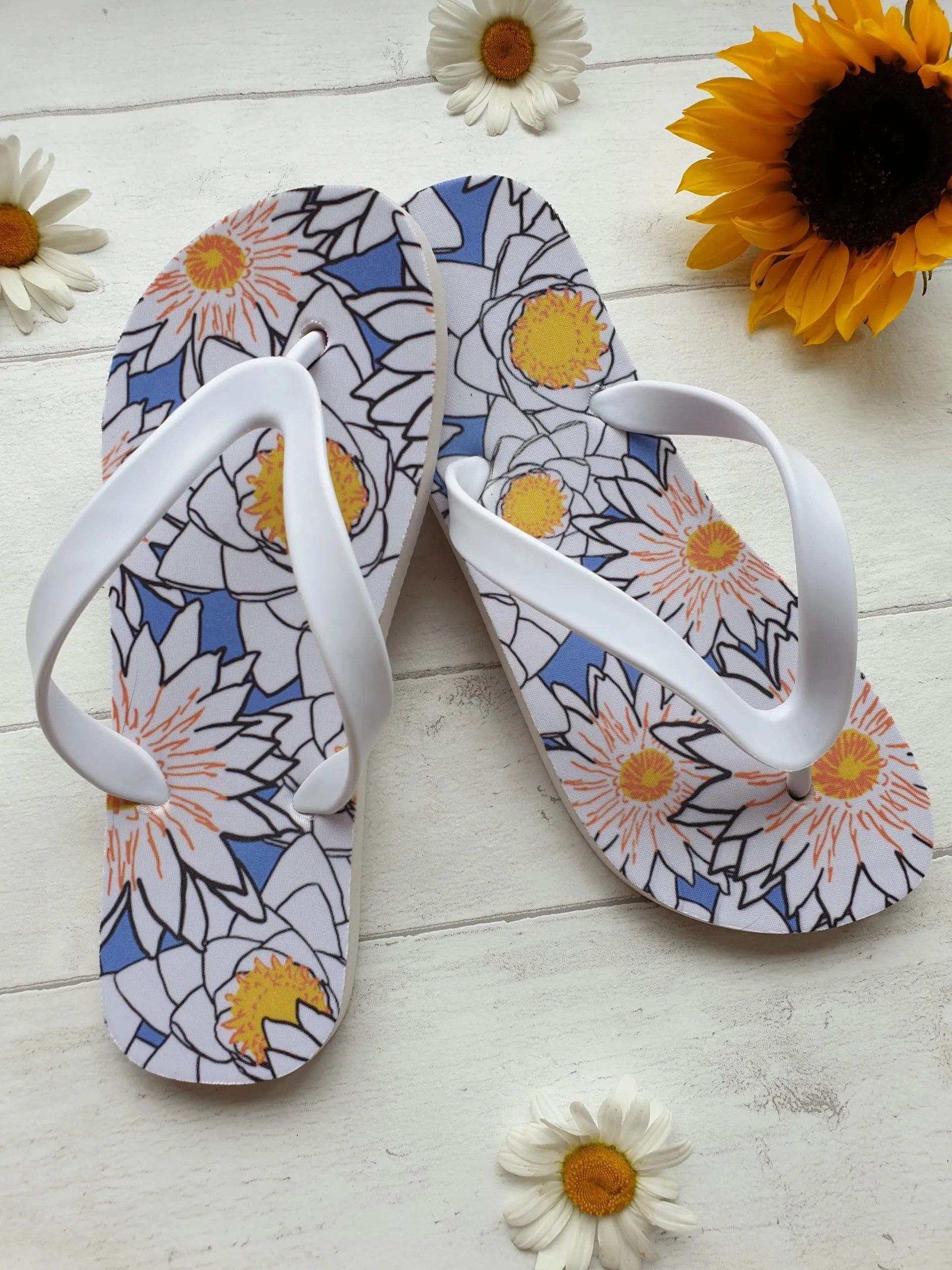 Flip Flops with a blue, yellow and white Lotus print