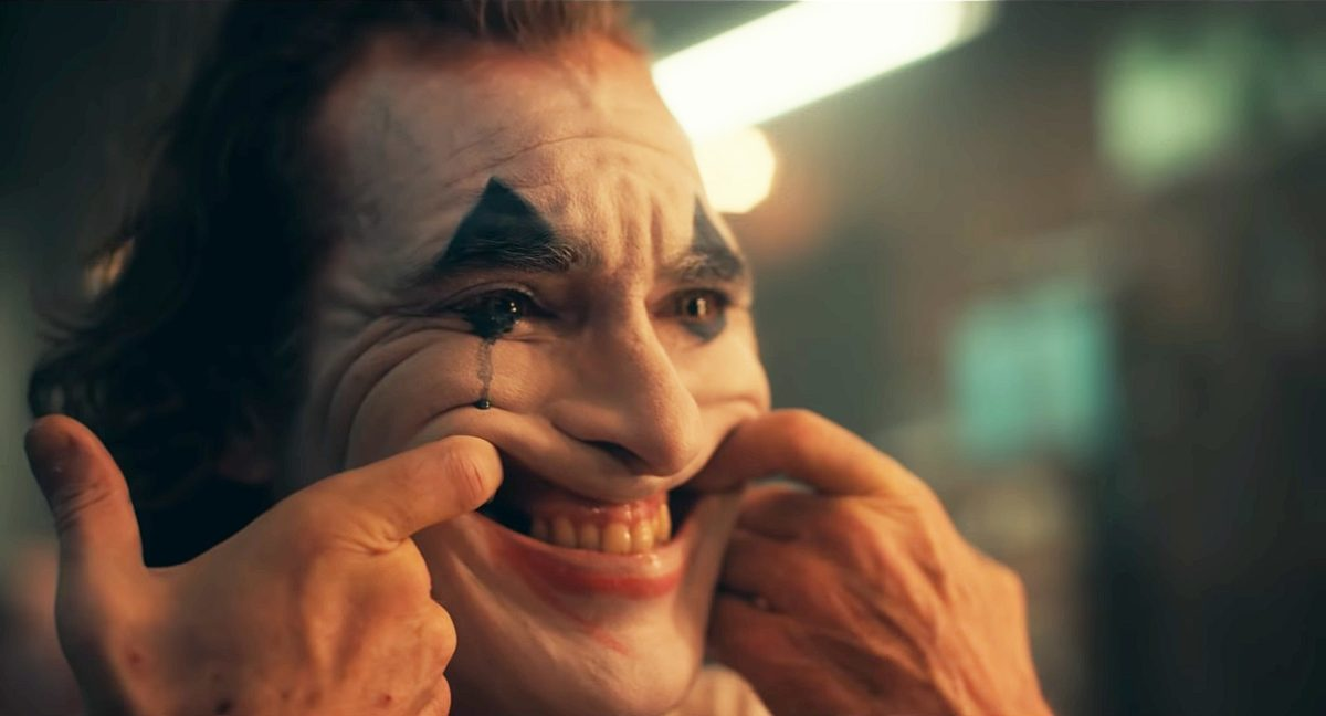 Joaquin Phoenix forces a smile in Todd Phillips' overrated Joker (2019)