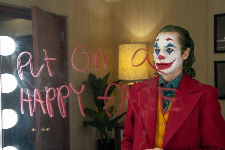 Joaquin Phoenix looks in the mirror in Todd Phillips' overrated 2019 Joker movie