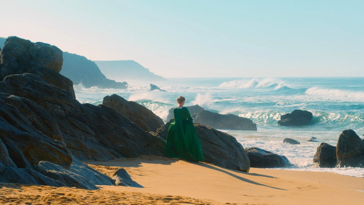 Still image of Adèle Haenel looking at the waves from Céline Sciamma's 2019 film Portrait of a Lady on Fire