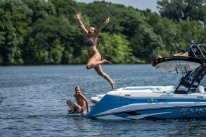 Kids having fun jumping and swimming with the Varatti boat surf gate.