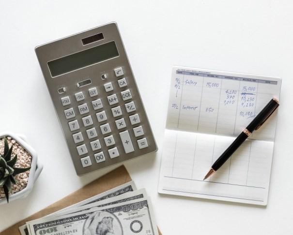 calculator pen cash and note