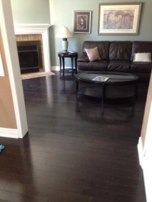 A dark hardwood floor, installed by Floors Direct North