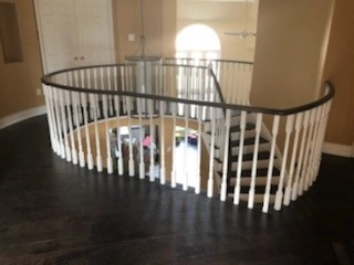 A custom staircase and pickets by Floors Direct North