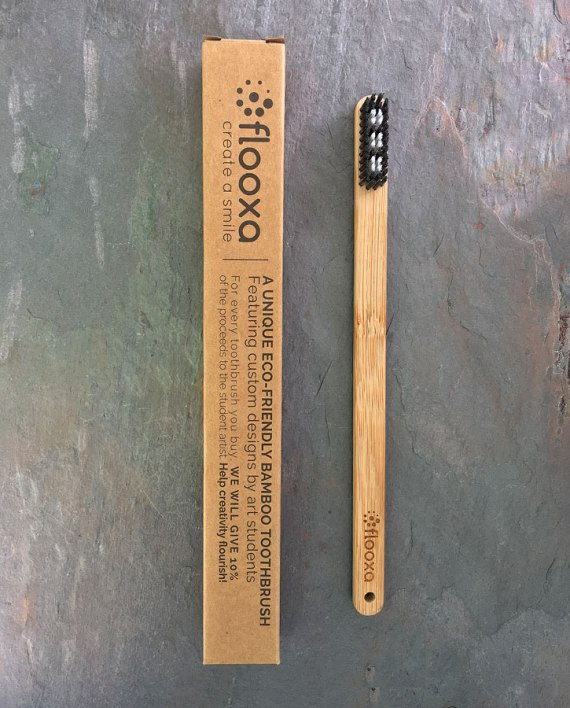 Bamboo toothbrush – Artwork by Charlotte Danois front view and packaging