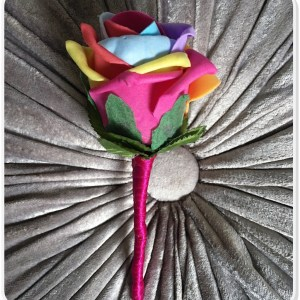 artificial rainbow rose buttonhole