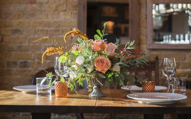 Autumn wedding flowers table arrangement