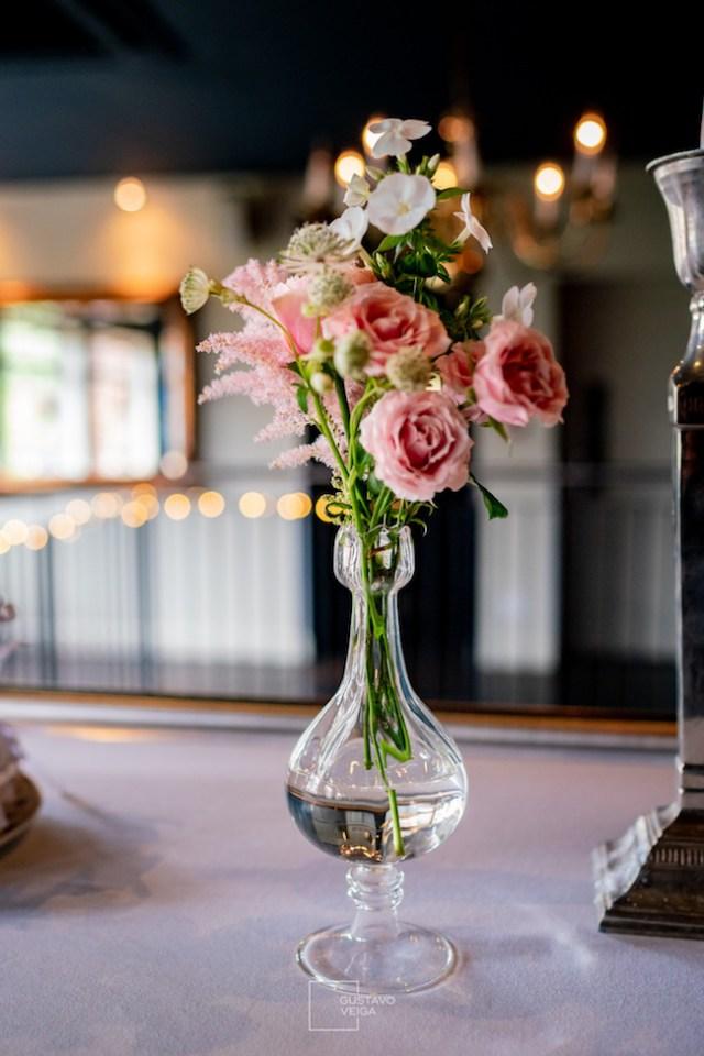 Pretty glass vase of wedding flowers