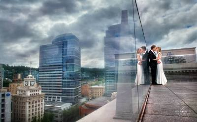 A reflection of love atop The Nines with a view of the mercurial skies of Portland.