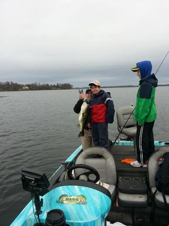 Father and sons fishing on lake toho orlando bass for Lake toho fishing guides