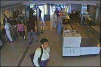 Hijacker Khalid al Mihdhar, foreground, passes through security at Dulles International Airport hours before American Airlines Flight 77 slammed into the Pentagon