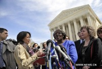 Betty Dukes (C), one of the six named plaintiffs, speaks to the media outside the U.S. Supreme Court on March 29, 2011. (Xinhua/Zhang Jun)