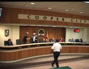 A Broward Sheriff's captain intervenes to calm overheated Cooper City politicians last year.