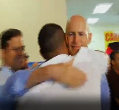 Gov. Scott and Duarte-Torres embrace in the Scott campaign ad