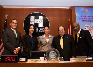 Hallandale Beach Mayor Joy Cooper is flanked on the left by Commissioners Keith London and Michele Lazarow and on the right by Commissioners Bill Julian and Anthony Sanders. The commission also sits at the city CRA's board of directors
