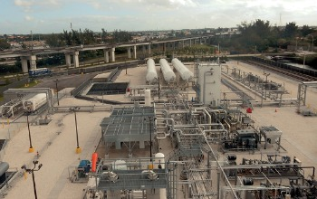 Gray and white piping at LNG production complex in Hialeah rail yard.