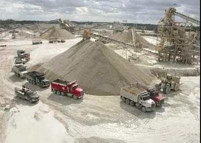 Dump trucks line up at White Rock's limerock crushing plant.
