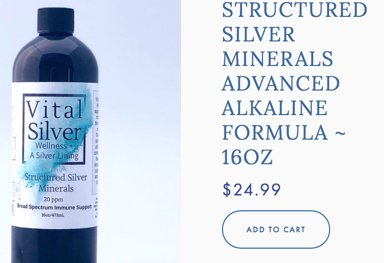 """A silver bottle with white label that reads:; """"Vital Silver Wellness + A Silver Lining"""""""
