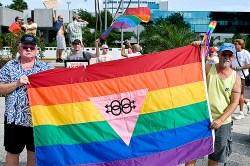 men holding gay flag.jpg