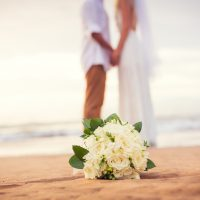 Just married couple holding hands on the beach, Hawaii Beach Wed