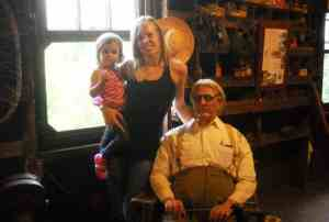 Mallory Smallwood McMillan and her 2-year-old Ava stand with a mannequin of Ted Smallwood, Mallory's great-grandfather