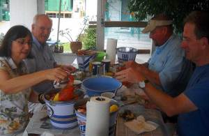 Cracking open blue crabs at Peace River Seafood in Punta Gorda