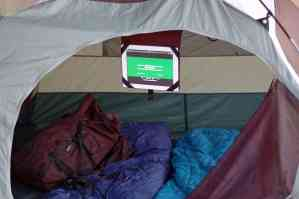 iPad hanging from roof of tent
