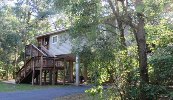 Lafayette Springs' cabins are expansive two-bedrooms houses on stilts set in lovely quiet woods.