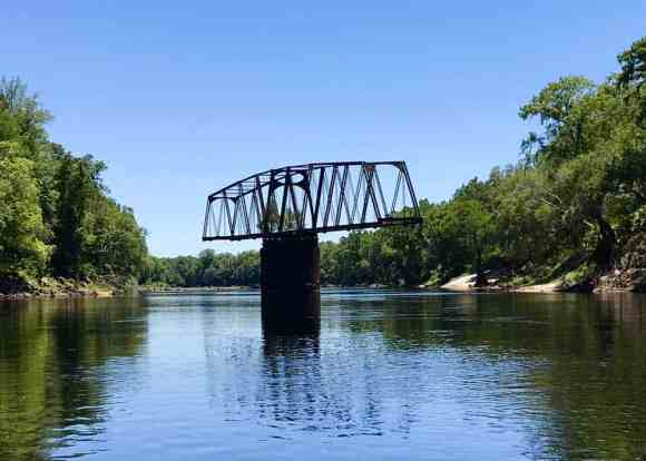 This rusty relic along the Suwanee River is a railroad swing bridge from the 19th century that was purchased from Brazil and used for a few decades in the early days of Florida railroads. (Photo: Bonnie Gross)
