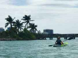 Kayaking past the fishing pier in the lagoon area of Oleta River State Park. (Photo: Bonnie Gross)