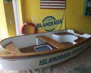 Boat and sand pile whre kids can play in the Islamorada Beer Company tasting room