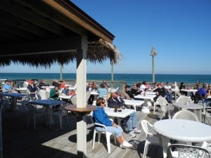 Dining on the deck while listening to music at the Sebastian Beach Inn