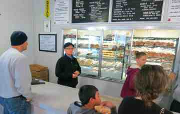 Inside the bakery at Knaus Berry Farm: If you peer through those windows, you see staff at work making those famous rolls.