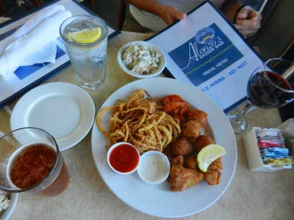 We shared Alonzo's sampler: four conch fritters, four Buffalo shrimp, four fish fingers and a pile of onion rings. That would be $17.30, but happy hour prices made it $8.65.