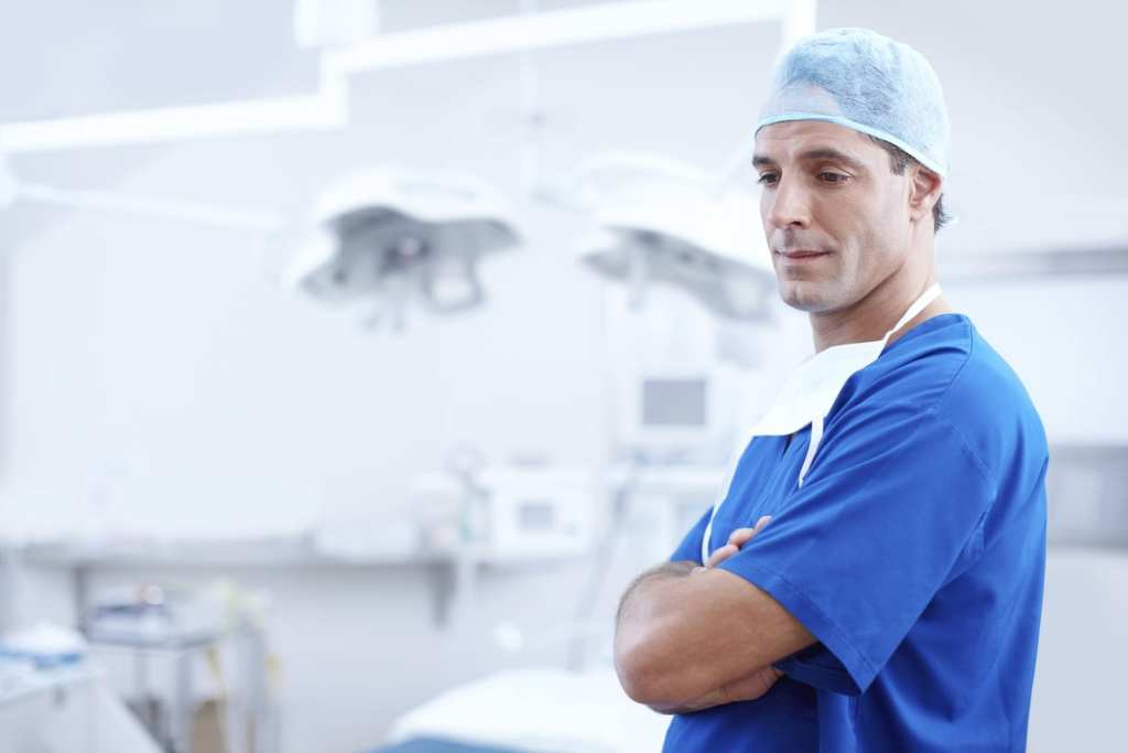 Neurosurgeon about to perform spinal cord stimulation surgery in Florida