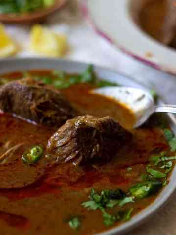 a bowl of nihari with a spoon in it