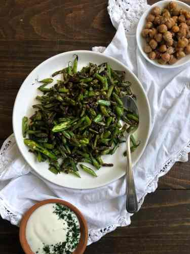 Green bean sabzi, two smaller dishes with chickpeas and yogurt