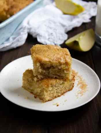 Two pieces of Apple Cake stacked on a plate